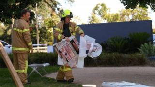 "Fire crews remove evidence in bags marked ""asbestos"" from South Korea's consulate in Melbourne"