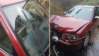 Car with cracked windscreen & bucked bonnet