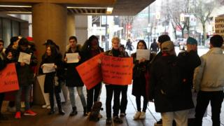 """People hold placards reading """"Free Ms Meng"""" outside court on day one Meng Wanzhou's extradition hearing"""