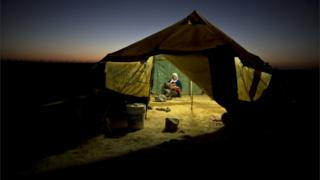 Woman and child refugee in a tent (Image: AP)