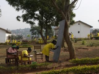 The women in Luzira prison hold classes under trees