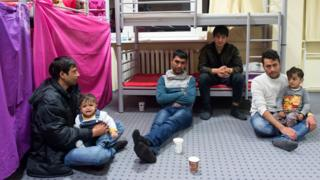 Afghan migrants sit in their room in the initial reception centre for asylum seekers in a former miners' hospital in Gera, central Germany (18 Feb. 2016)