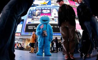 Times Square's heavy pedestrian traffic has attracted dozens of costumed performers