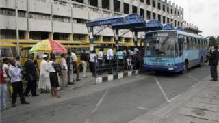 Commuters queue to board the Bus Rapid Transit (BRT) established to alleviate transportation problems in Lagos on 11 March 11 2009.