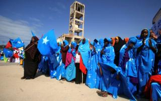 Residents dressed in national colours attend Independence day celebrations outside the ruins of the former Parliament buildings in Mogadishu, Somalia July 1, 2016