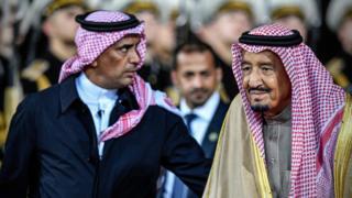 Saudi Arabia's King Salman bin Abdulaziz al-Saud accompanied by his personal bodyguard Gen Abdul Aziz al-Fagham (4 October 2017)