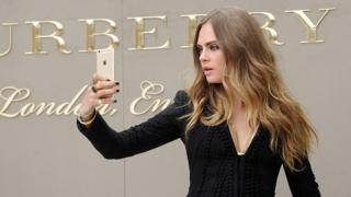 Cara Delevingne attends the Burberry Womenswear Spring/Summer 2016 show