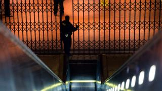 A police officer walks through the entrance to the closed Metro Center Metro station in Washington