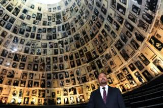 Ethiopia's Prime Minister Abiy Ahmed looks at pictures of Jewish Holocaust victims at the Hall of Names on September 1, 2019 during his visit to the Yad Vashem Holocaust Memorial museum in Jerusalem