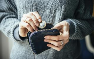 Woman takes money out of purse