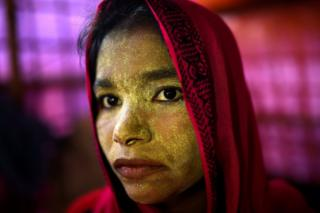 Rohingya refugee Laila Begum, aged 23, poses for a photograph as she wears thanaka paste at Balukhali camp in Cox's Bazaar, Bangladesh