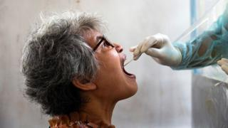 A woman is tested for coronavirus in Bangkok, Thailand - 28 April 2020