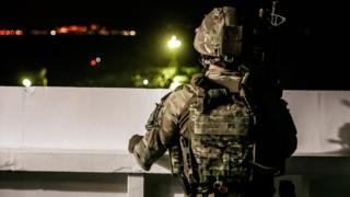 Royal Marine on the bridge of Grace 1
