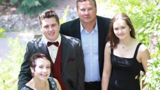 Evan Thomas with parents and sister