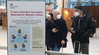 Passengers at Heathrow wearing faces masks