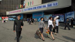 North Korean visitors leave the the 13th International Trade Fair in Pyongyang on September 25, 2017
