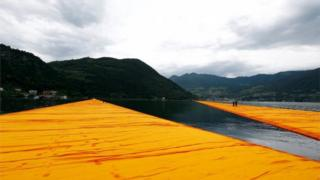 view from the art installation The Floating Piers by Bulgarian-born artist known as Christo on Lake Iseo, northern Italy,
