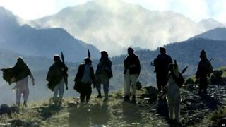 Mujahideen fighters pictured on an Afghan mountain in 2001