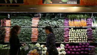 Customers shop for produce at a Whole Foods market on October 15, 2014 in San Francisco, California.