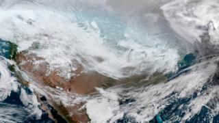 A satellite image of the continental United States shows the extreme cold weather phenomenon called the polar vortex over the U.S. Midwest and Great Lakes regions