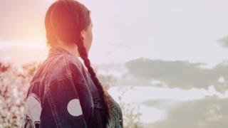A woman looking far away