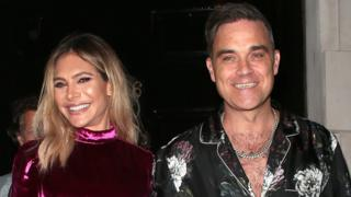 L to R: Ayda Field and Robbie Williams