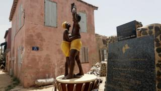 """A statue commemorating the abolition of slavery stands in front of the House of Slaves museum, before being relocated to the """"Freedom and Human Dignity"""" Square, on Goree island, off the coast of Dakar, Senegal July 3, 2020"""