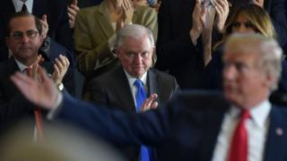 US Attorney General Jeff Sessions (centre) applauds Donald Trump (file photo)