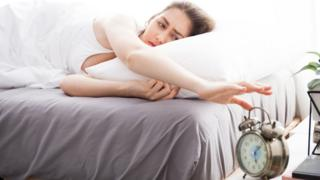 Woman to turn electric clock