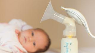 Baby and breast pump