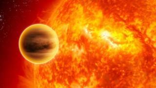 Un planeta al lado de una estrella
