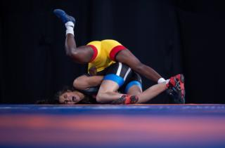 "A handout photo made available by the OIS/IOC shows Zaineb Sghaier of Tunisia (blue) in action against Natacha Veronique Nabaina of Cameroon (yellow) in the Wrestling Women""s Freestyle 65kg Group B at the Asia Pavilion, Youth Olympic Park during The Youth Olympic Games, Buenos Aires, Argentina, 13 October 2018."