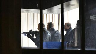Armed police officers inside London Central Mosque, near Regent's Park