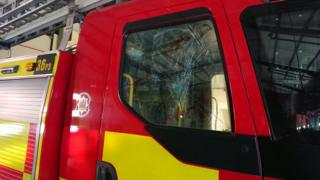 Smashed fire engine window