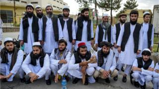 Taliban prisoners pose as they are in the process of being potentially released from Pul-e-Charkhi prison, on the outskirts of Kabul on July 31, 2020.