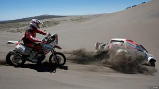 Racers participate in the 2014 Dakar Rally 06 January 2014