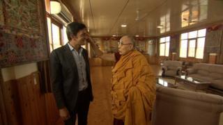 BBC correspondent Justin Rowlatt (L) meets the Dalai Lama