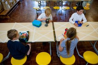 May 18 2020. Children of essential workers eat lunch in segregated positions at Kempsey Primary School in Worcester. Nursery and primary pupils could return to classes from June 1 following the announcement of plans for a phased reopening of schools.
