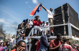 Protesters with loudspeakers in Haiti