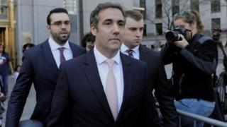 Michael Cohen departs federal court in Manhattan.