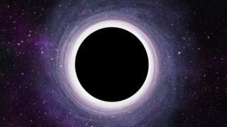 Ilustración de un agujero negro.