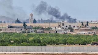 Smoke rises from attacks on IS targets just inside Syria (May 2016)