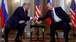 Trump and Putin shake hands at the Helsinki summit