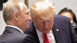 Vladimir Putin and Donald Trump talk during an economic summit