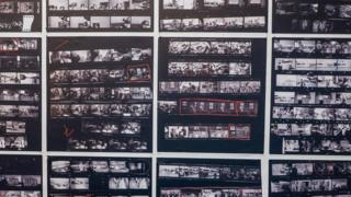 "Enlarged contact sheets from photographer Robert Frank's groundbreaking book ""The Americans"" at Blue Sky Gallery in Portland, Oregon, USA."
