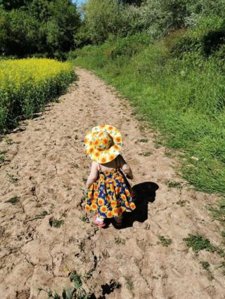 Girl walking on a path