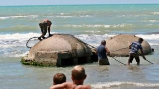 Bunkers on a beach being removed