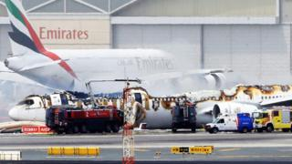 An Emirates airlines Boeing 777-300 A6-EMW plane flight number EK521 from Trivandrum to Dubai lays on the ground in Dubai airport after being gutted by fire due to a mechanical failure at Dubai international airport, Dubai, United Arab Emirates, 3 August 2016.