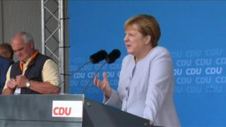 Angela Merkel on stage at event in Zingst, in north-eastern Germany (11 July 2016)