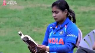 The captain of Indian women's cricket team Mithali Raj reading a book